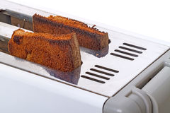 Fried toast in the toaster Royalty Free Stock Image