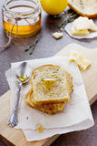 Fried toasts with honey and cheese. On a kitchen board Stock Image