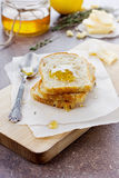 Fried toasts with honey. And cheese on a kitchen board Royalty Free Stock Images
