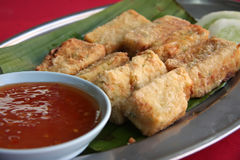 Fried tofu. Beancurd with dipping sauce traditional chinese cuisine Royalty Free Stock Photography