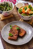 Fried tofu cheese, salad with beans and Korean salad on the table royalty free stock photo