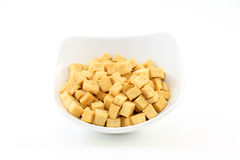 Fried Tofu Soy Bean Curd. Fried cubes of bean curd (tofu) in white dish; white background Stock Image