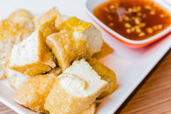 Fried Tofu with sweet souce. Close up fried Tofu with sweet souce royalty free stock image