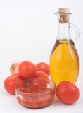 Fried tomato. Olive oil, tomatos and onion royalty free stock image