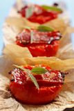 Fried tomato halves with bacon and sage Royalty Free Stock Photos