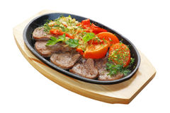 Fried tongue with vegetables on carving board. (session in restaurant royalty free stock images