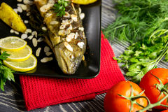 Fried trout with almonds Stock Images