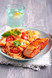 Fried trout fish and spaghetti Royalty Free Stock Photo