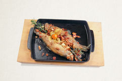 Fried trout with garlic and rosemary Stock Photography
