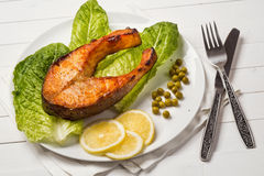 Fried trout with a piece of lettuce Royalty Free Stock Images