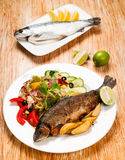 Fried trout and potato wedges Stock Photography