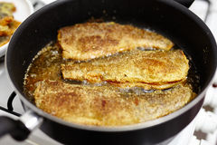 Fried trout preparation Royalty Free Stock Photos