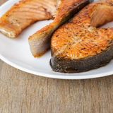 Fried trout steaks on plate Stock Photos