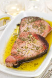 Fried tuna with olive oil and garlic Stock Image