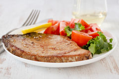 Fried tuna with salad Stock Images