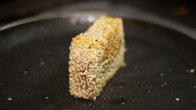 Fried tuna steak on the hot pan. Closeup shot stock footage