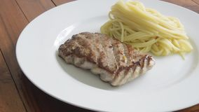 Fried tuna steak on the hot pan. HD stock footage