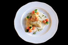 Fried turbot fillet in filo pastry with vegetables Stock Photography
