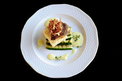 Fried turbot fillet with zucchini and crispy crust Stock Images