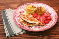 Fried turkey fillets, roasted potatoes and cherry tomato Royalty Free Stock Image