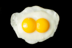 Fried two-yolks egg Stock Photos