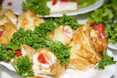 Fried vegetable marrow. With sour cream parsley and a tomato stock photos