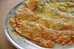 Fried vegetable omelet. Thai style fried vegetable omelet serving in flat plate Stock Photo