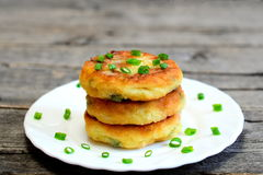 Fried vegetable patties on a plate. Yummy patties made of potatoes, green peas, carrot and green beans Stock Photography