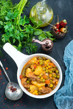 Fried vegetables. In bowl and on a table Royalty Free Stock Images
