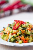 Fried vegetables cubes, Ratatouille, zucchini, red pepper Royalty Free Stock Photos
