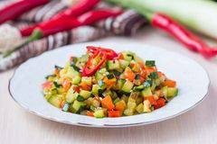 Fried vegetables cubes, Ratatouille, zucchini, red pepper Stock Photos