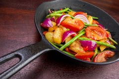 Fried vegetables. Frying pan with cooked vegetables Royalty Free Stock Photos