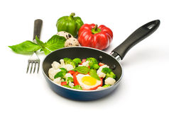 Fried with vegetables in a pan Royalty Free Stock Photo