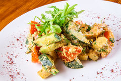 Fried vegetables with walnut sauce Royalty Free Stock Photos