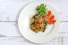 Fried Vermicelli with mushroom and dried shrimps on white ceramic plate then put it on wooden table. Fried Vermicelli with mushroom and dried shrimps on white royalty free stock photo