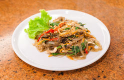 Fried vermicelli with mushroom and white sesame on white plate,. Korean food Royalty Free Stock Image