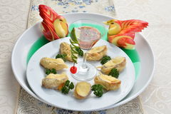 Fried wanton with cocktail and duck apple on white plate in rest Stock Photos