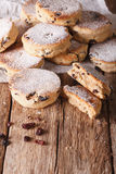Fried Welsh cakes with raisins and powdered sugar close-up. vert Royalty Free Stock Image