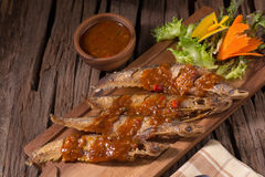 Fried Whisker sheat fish with chili sauce Royalty Free Stock Photo