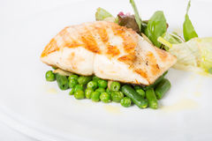 Fried white fish fillet with garnish Stock Image