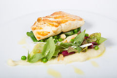 Fried white fish fillet with garnish Royalty Free Stock Photography