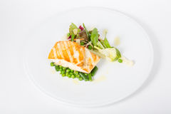Fried white fish fillet with garnish Royalty Free Stock Images