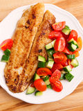 Fried white fish with salad Stock Photography