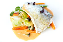 Fried whitefish. Fillet stir-fried with green vegetables, jasmine rice, carrot salad and a creamy shrimp sauce Stock Image