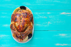 Fried whole chicken with apples, prunes and lemons Royalty Free Stock Image