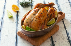 Fried whole chicken with potatoes and lemons Royalty Free Stock Photography