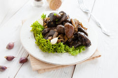 Fried wild mushrooms on white plate Royalty Free Stock Images