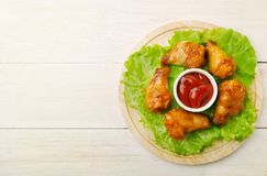 Fried wings with ketchup on a wooden backround. And place for text Stock Photography