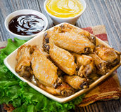 Fried wings with sauce. On the table Royalty Free Stock Image