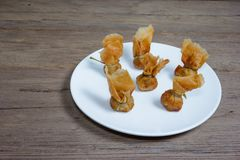 Fried wonton or Toong Tong on wood background Royalty Free Stock Image